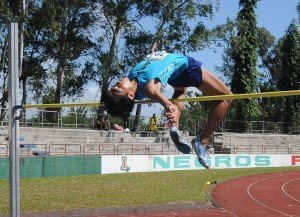 15 year old Alexis Soqueno of Negros First leaps an age grade and meet record for the 2013 Batang Pinoy Finals