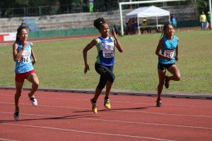 One name to watch out for 14 year old Karen Janario (880) of Tacloban holds off local girl Joycie Beronio (717) in the heats of the girls 100m.