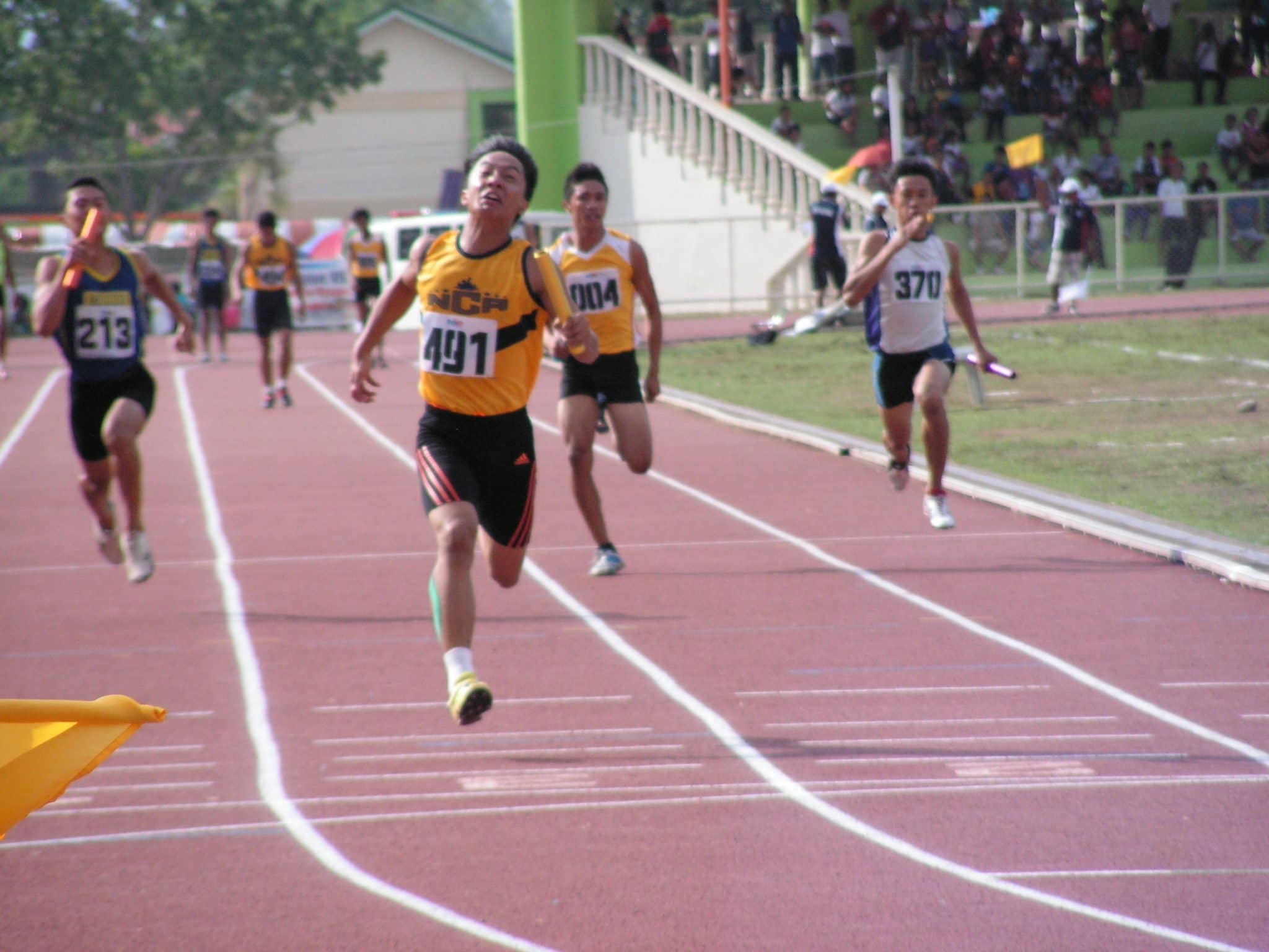 Team NCR on full throttle on the final stretch of 4x100m