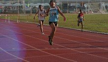 Alexis Soqueño at the finish line capturing gold in Palaro 400m hurdles.