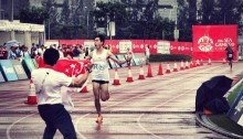 I am the SEA Games Champion Soh Roars as he crosses the line in tough weather conditions.