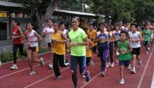 Khay Santos wearing her smile as she leads the warm-up.