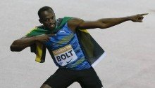 Usain Bolt celebrates after he wins the men's 100m final during the Diamond League athletics meeting at the Olympic Stadium in the Queen Elizabeth Olympic Park in London on Friday (THE ASSOCIATED PRESS)