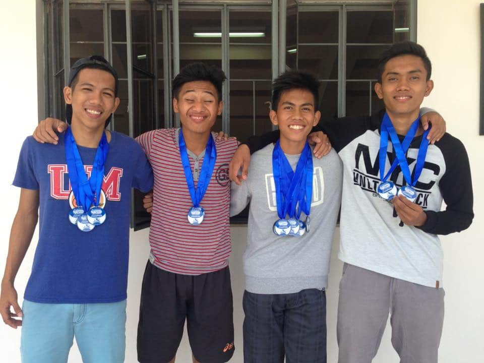Team Tagum showcasing their medals as they went victorious at the 4x100m Relay Open Men.